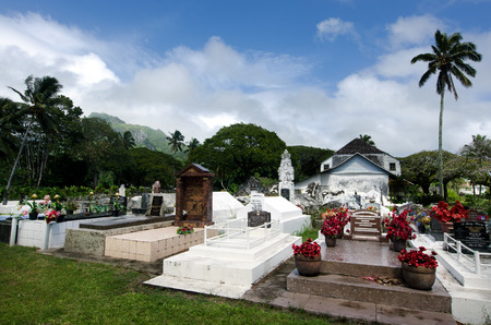 islanders: RAROTONGA - SEP 16:CICC church cemetery on Sep 16 2013.94% of Cook Islanders associated themselves with a faith.The Cook Islands Christian Church (CICC) dominant with 49% (7,356) members. Editorial