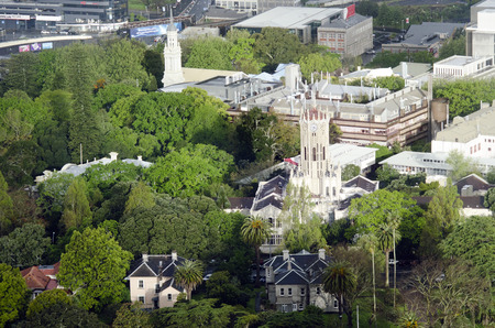 nz: AUCKLAND, NZ - OCT 08:Aerial view of the clock tower building of University of Auckland on Oct 08 2013.Its the largest university in NZ, and was ranked 82nd worldwide in the 2011 QS World University Rankings.