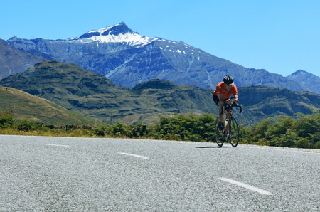 WANAKA, NZ - JAN 17:A man ride sport bike in Mount Aspiring National Park on Jan 17 2014.Its part of the Southern Alps of the South Island of NZ and the Te Wahipounamu World Heritage site.