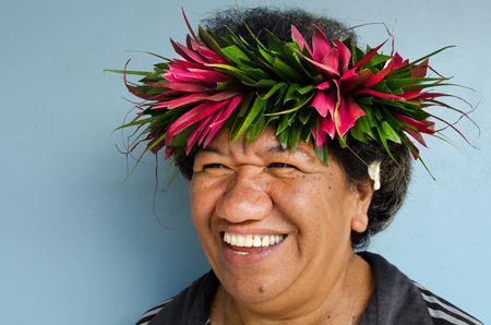 islanders: RAROTONGA - SEP 21:Exotic flowers on Cook Islanders woman hair on Sep 21 2013.The Cook Islands main population centres are on the island of Rarotonga (14,153 in 2006).