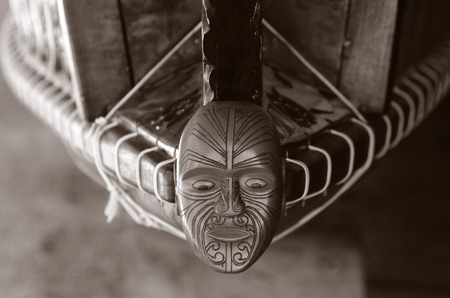 national trust: WAITANGI - JAN 07: Wood curving decoration on the 35 metre Maori Waka (war canoe) on Jan 07 2014 in Waitangi National Reserve, Bay of Islands, Far North District, Northland Region, New Zealand (NZ). (BW)