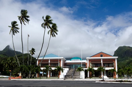 enforce: RAROTONGA - SEP 16:Cook Islander pass by the Cook Islands Parliament on Sep 16 2013.Originally established under New Zealand colonial rule, it became the national legislature on independence in 1965.
