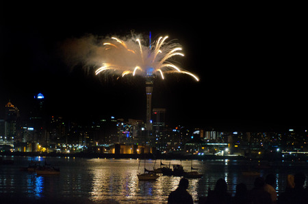 turns of the year: AUCKLAND,NZ - JAN 01:Fireworks displays from Auckland Sky Tower to welcome 2014 on JAN 01 2014.New Zealand is one of the first countries to observe the New Year. Editorial