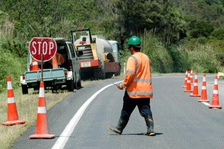 earliest: CABLE BAY, NZ - DEC 12:Road worker slows traffic with stop sign on Dec 12 2013.The earliest roads were perhaps built in about 3500 BC in the Middle East. Editorial