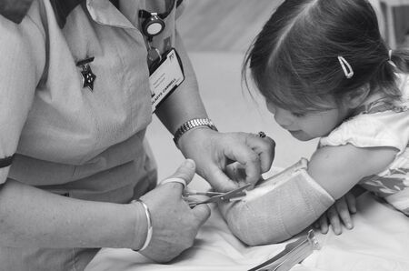 fractures: KAITAIA, NZ  - MAR 27 2014:Nurse removing an arm orthopedic cast of a child (Talya Ben-Ari age 3). Forearm fractures account for 40% to 50% of all childhood fractures. (BW)