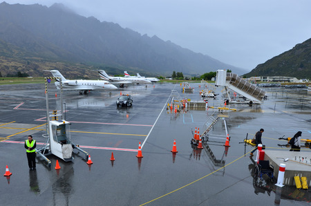 scheduled: QUEENSTOWN, NZ - JAN 18:Queenstown Airport on Jan 18 2014.Its the fourth busiest airport in NZ by passenger traffic handled 924,248 airline scheduled passengers in 2011. Editorial