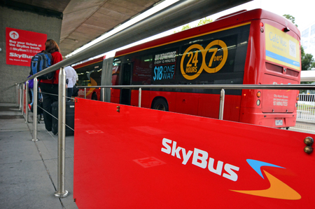super cross: MELBOURNE - APR 10, 2014:Skybus Super Shuttle in Tullamarine Melbourne airport.Skybus carries over 2 million passengers per year and 8.3% of all Tullamarine Melbourne airport passengers Editorial