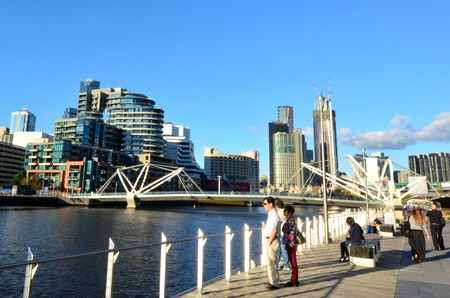 Footbridge: MELBOURNE,AUS - APR 14 2014:Visitors looks at the Seafarers Bridge.Its a popular and famous footbridge over the Yarra River between Docklands and South Wharf in Melbourne, Victoria, Australia.