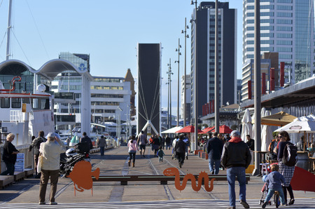 reclamation: AUCKLAND - JUNE 01 2014:Visitors in Auckland Wynyard Quarter. Auckland has been rated one of the worlds top 10 cities to visit by travel bible Lonely Planet.