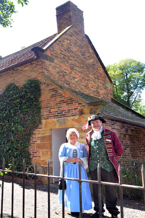 century: MELBOURNE, AUS - APR 14 2014:Couple wearing English costumes from the 17th century era at Captain Cooks Cottage.Its a popular tourist attraction located in the Fitzroy Gardens, Melbourne, Australia. Editorial