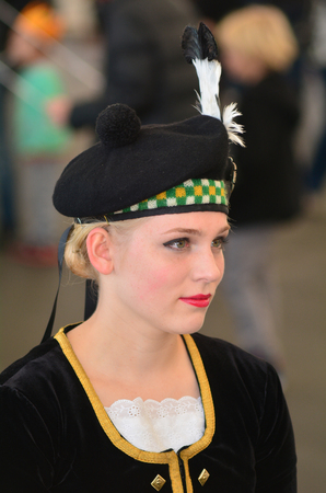queen's birthday: AUCKLAND,NZ - JUNE 01 2014:New Zealander dressed as a Scottish girl celebrate the Queens Birthday on the first Monday of June each year as the Queen of the United Kingdom being the head of state. Editorial
