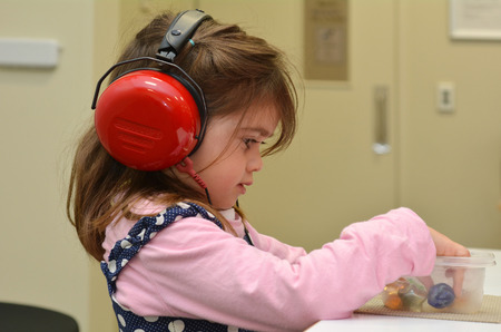 AUCKLAND - JULY 30 2014: Hearing check for pre-school child (Talya Ben-Ari age 4). It's done by  hearing technician to try picks up most hearing problems in children before their first year at school. Éditoriale