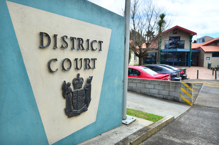 court proceedings: KAITAIA, NZL - AUG 18 2014:Kaitaia DistrictFamily Court outdoor sign and symbol.It is the most northern District Court in new zealand Editorial
