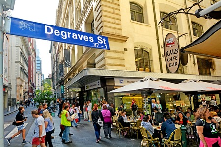 lanes: MELBOURNE, AUS - APR 11 2014:Traffic on Degraves Street, one of Melbournes finest Laneway environments. Full of bars,restaurants, cafe and boutique shopping.