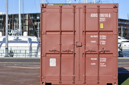 intermodal: AUCKLAND - JUNE 01 2014:A Container in a sea port.There are over 17 million shipping containers in the world and 6 million of them are currently zipping around the world on vessels, trucks and trains.