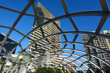 webb: MELBOURNE,AUS - APR 14 2014:Webb Bridge against towers of Yarras Edge at Docklands in Melbourne, Australia.Its a residential precinct apartment towers, costing a $1.3 billion (AUS) cover 0.15 km2.