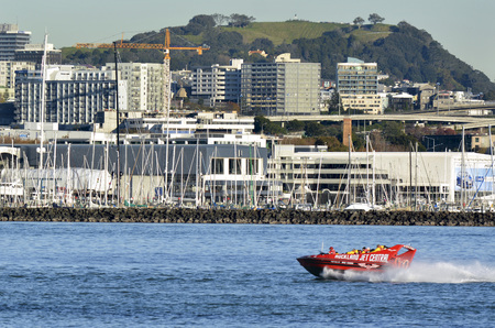85 90: AUCKLAND - MAY 28 2014:Auckland Jet boat adventure tours in Waitemata Harbour.The speed boat, Ruby Red Lips, top Speed is 42 knots  85 - 90 Kms with the capacity of 23 passengers.