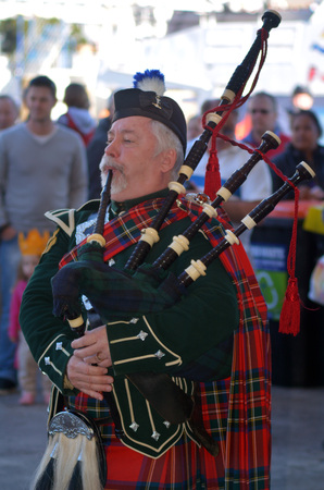 bagpipes: AUCKLAND,NZ - JUNE 01 2014:Bagpipe player celebrate the Queens Birthday on the first Monday of June each year as the Queen of the United Kingdom being the head of state.