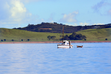 tourist destinations: PAIHIA,NZ - MAY 11 2014:Old motorboat sail in the Bay of Islands.It is one of the most popular fishing, sailing and tourist destinations in New Zealand.