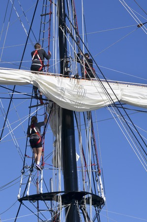 pirate crew: AUCKLAND - JUNE 01 2014:Sailors climb on to of the mast of Spirit of New Zealand. Its a tall ship with steel-hulled, three-masted barquentine that was built by the Spirit of Adventure Trust in 1986.