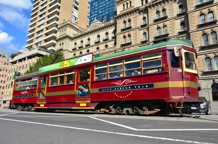 electric tram: MELBOURNE, AUS - APR 14 2014: W class tram in City Circle service.Its a zero-fare tram  aimed mainly for tourists running around the central business district of Melbourne, Australia.