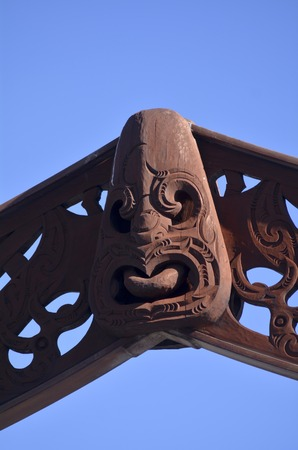 aotearoa: AUCKLAND - JUNE 01 2014:Wood curving figure of a Maori male.Maori are the indigenous people of New Zealand. Originally from Polynesia, Maori migrated to New Zealand over 1000 years ago.