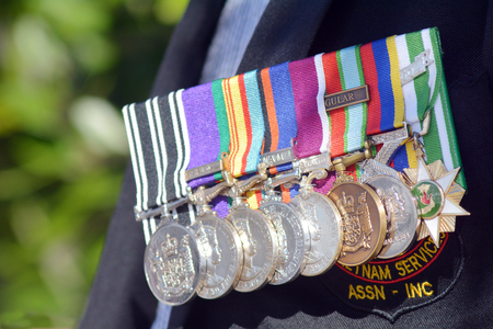 national military cemetery: Close up of war medals on New Zealander soldier during a National War Memorial Anzac Day services in New Zealand. Editorial