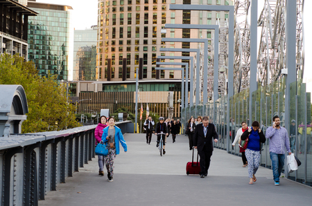 southbank: MELBOURNE,AUS - APR 14 2014:Pedestrian cross Sandridge Bridge.Its an historic former railway bridge from the Victorian era and today its a popular pedestrian and cycle path featuring public art.