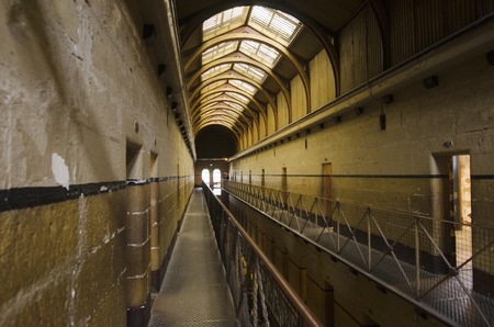 penal: MELBOURNE - APR 11 2014:Old Melbourne Gaol interior, As of 2010, the gaol is recognized as Victorias oldest surviving penal establishment, and attracts approximately 140,000 visitors per year