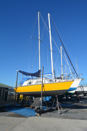 beached: PAIHIA,NZ - MAY 11 2014:Sail yachts beached at a dock for painting ,repair and maintenance in Opua Marina. Its a 250-berth Marina,popular destination for cruising yachts to NZ from all over the world.