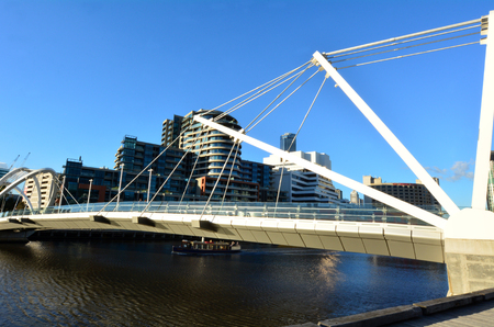 Footbridge: MELBOURNE,AUS - APR 14 2014:Padestrian croos over the Seafarers Bridge.Its a popular and famous footbridge over the Yarra River between Docklands and South Wharf in Melbourne, Victoria, Australia.