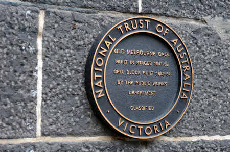 gaol: MELBOURNE - APR 11 2014:Old Melbourne Gaol sign, As of 2010, the gaol is recognized as Victorias oldest surviving penal establishment, and attracts approximately 140,000 visitors per year
