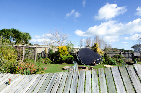 COOPERS BEACH, NZL - JULY 17 2014:Storm damaged garden.High winds lashing the upper North Island of New Zealand have knocked down trees, blown roofs off houses and cut power to thousands.