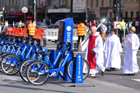 census: MELBOURNE, AUS - APR 14 2014:Anglicans carry a cross during Palm Sunday.Religion in Australia is predominantly Christian. In the 2011 Census, 60% of the Australian population are Christians.