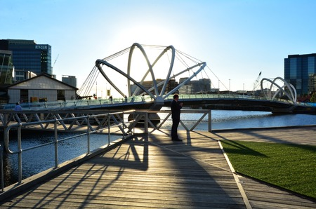 MELBOURNE,AUS - APR 14 2014:Visitors at Seafarers Bridge.Its a popular and famous footbridge over the Yarra River between Docklands and South Wharf in Melbourne, Victoria, Australia.