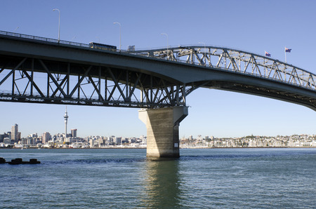 presently: AUCKLAND,NZ - MAY 27 2014:Traffic on Auckland Harbor Bridge.The daily average number of cars crossing the Auckland Harbour Bridge is presently around 165,000
