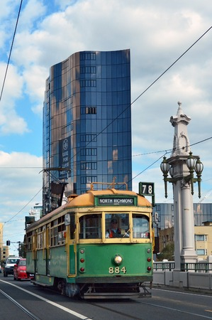brige: MELBOURNE, AUS - APR 14 2014:Melbourne tramway  Church Brige.Its the largest urban tramway network in the world. The network consisted of 250 km (155.3 mi) of track, 487 trams, 30 routes and 1,763 tram stops