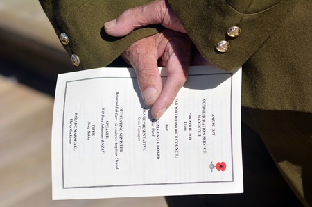 new world order: New Zealand Army veteran soldier hands holds  ANZAC order of service during a National War Memorial Anzac Day in New Zealand. Editorial