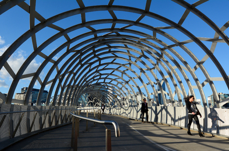 webb: MELBOURNE,AUS - APR 14 2014:Pedestrians cross on Webb Bridge.Its an award winning bridge forming a cycling and pedestrian link to the main part of Docklands, through Docklands Park.