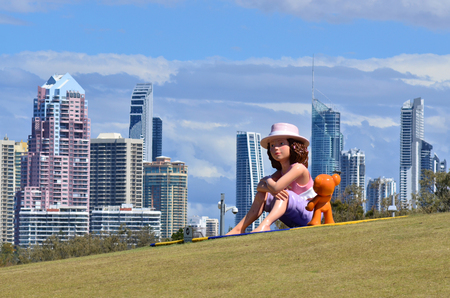 fibreglass: GOLD COAST - OCT 16:  Fibreglass sculpture of a child and her teddy bear in THE HILL at Southport Broadwater Parklands in Gold Coast Queensland Australia.Its  a 2.5-metre (8 ft 2 in) high. Editorial