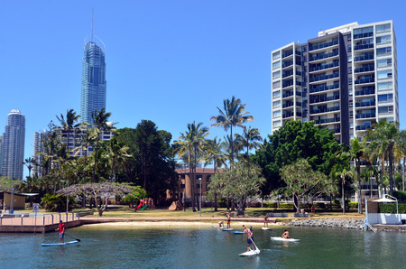 navigable: SURFERS PARADISE  - OCT 29 2014:People paddle board over Nerang River.With 9 times more waterways than Venice, Gold Coast is a boating paradise with over 260 Km of navigable waterways within the city. Editorial