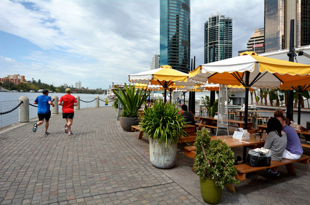 unrivaled: BRISBANE, AUS - SEP 25 2014:Activity at Eagle Street Pier.It is an iconic waterfront precinct with world class dining options and unrivaled views of the Brisbane River.