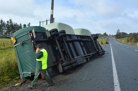 high winds: AUCKLAND , NZL - SEP 22 2014: Truck accident during high winds storm in New Zealand.Truck companies require to advise their truck drivers to use extreme caution when driving under adverse conditions.