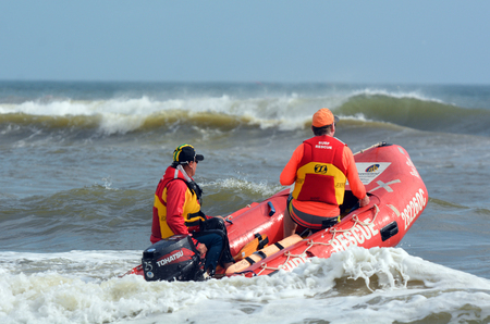 gold coast: GOLD COAST, AUS - NOV 02 2014:Australian Lifeguards in Gold Coast Australia.Australian Lifeguards are world-renown for their high levels of skill and knowledge in accident prevention and rescue response Editorial