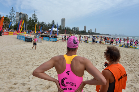coolangatta: GOLD COAST, AUS - NOV 2 2014:Men race in Coolangatta Gold 2014.The Coolangatta Gold is the toughest race in ironman, and one of the toughest in world sport.