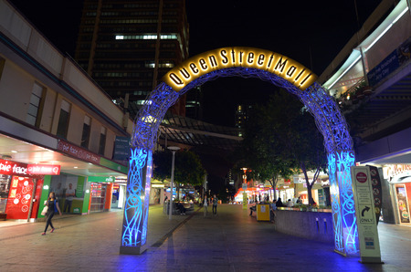 BRISBANE, AUS - SEP 25 2014:Visitors at Queen Street Mall at night.It is a pedestrian mall with more than 700 retailers with six major shopping centres. It receives over 26 million visitors each year Editorial