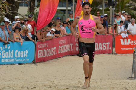 coolangatta: GOLD COAST, AUS - NOV 2 2014:Caine Eckstein race in Coolangatta Gold 2014.The five-time Gold champion was forced out of the race due to the pain of a torn bicep around 30km into the event.