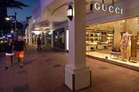 ranked: SURFERS PARADISE, AUS - OCT 26 2014:Gucci shop.In 2013 the brand was valued at $ 12.1 Billion USD with sales of $4.7 billion USD.In Forbes list for 2013, Gucci was ranked the 38th most valuable brand.