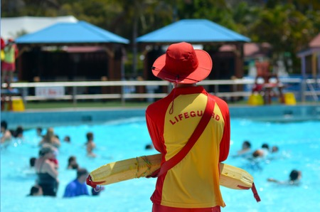 first australians: GOLD COAST, AUS - OCT 30 2014:Australian Lifeguard in WetnWild Gold Coast Australia.They are world-renown for their high levels of skill and knowledge in accident prevention and rescue response