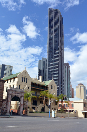 hallows: BRISBANE, AUS - SEP 25 2014:All Hallows heritage-listed Catholic school for girls under the Soleil tower. At 243m, it was Brisbanes tallest building until 2013 when Infinity Tower (249m) overtook it Editorial